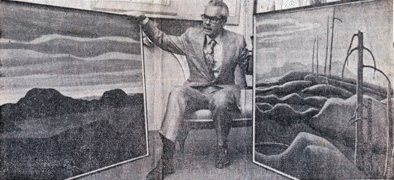 Walter Klinkhoff with two Lawren Harris canvases