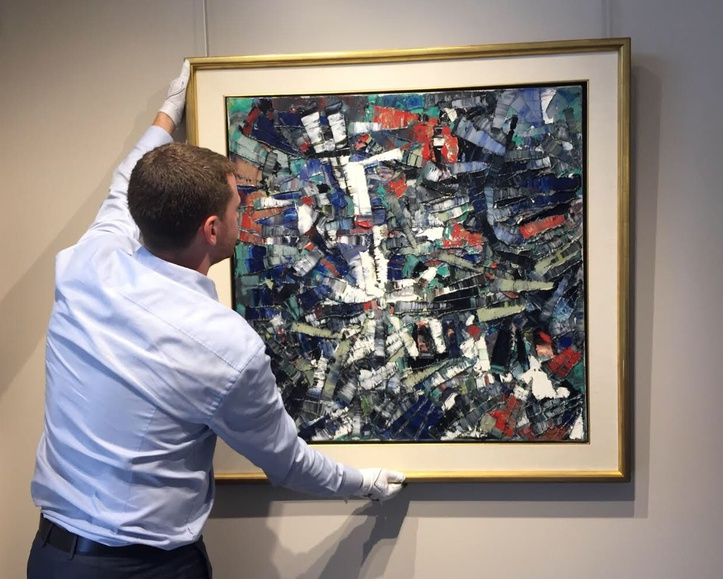 Craig Klinkhoff carefully hangs Passage, 1956 by Jean Paul Riopelle, which was sold by Alan Klinkhoff Gallery in 2018.