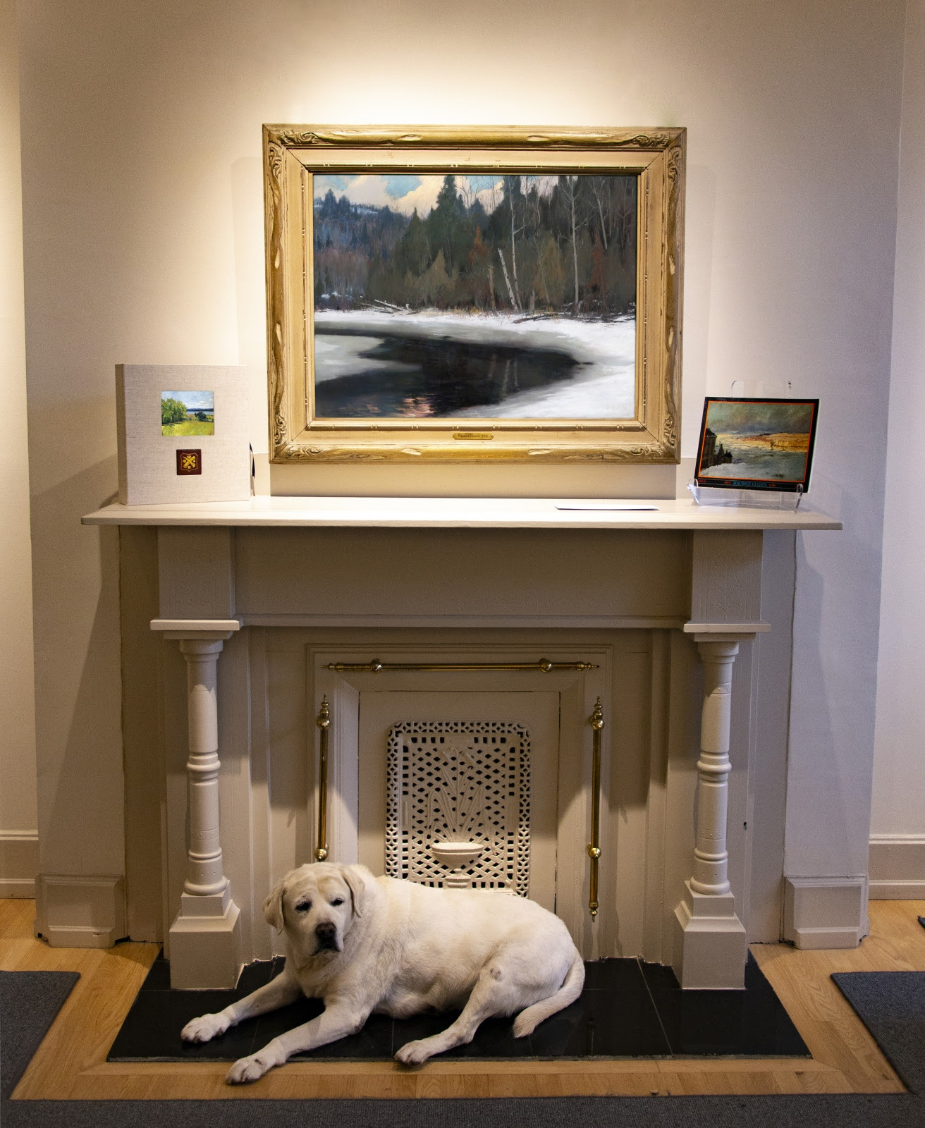wilight in the Laurentians above the fireplace at Galerie Alan Klinkhoff in Montreal, steadfastly protected by Winston.